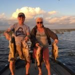 happy husband and wife largemouth on lake Okeechobee
