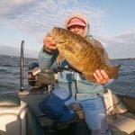 a man holding a largemouth bass